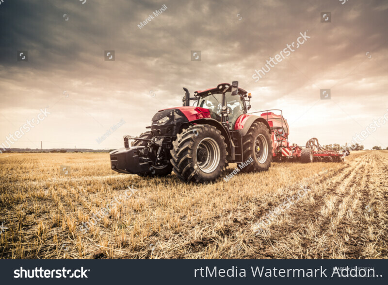 stock-photo-modern-red-tractor-seeding-directly-into-the-stubble-with-red-equipment-using-gps-for-precision-1328708744
